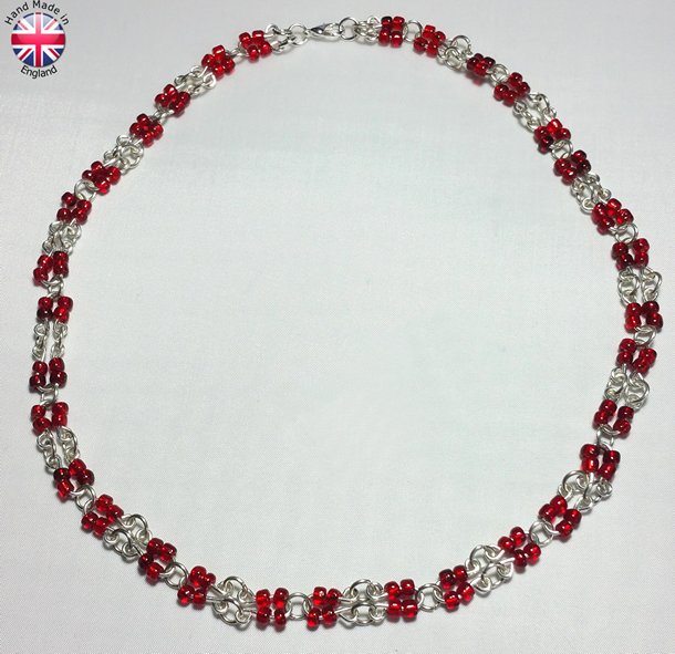Necklace Earings and Bracelet set of Hand made silver plate bead carriers and links with blood red acrylic beads.
