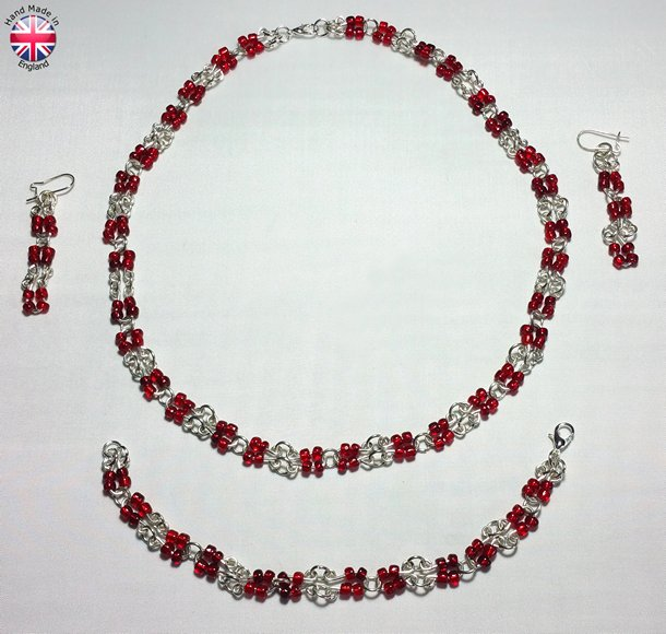 Necklace Earings and Bracelet set of Hand made silver plate bead carriers and links with blood red acrylic beads
