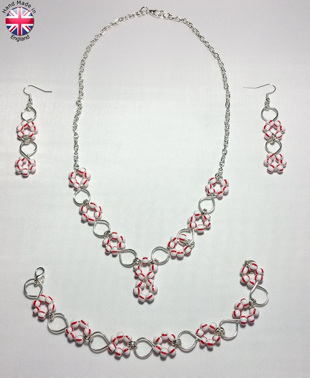 Necklace Earings and Bracelet set of Hand made silver plate figure eight links carrying white with red designer glass beads