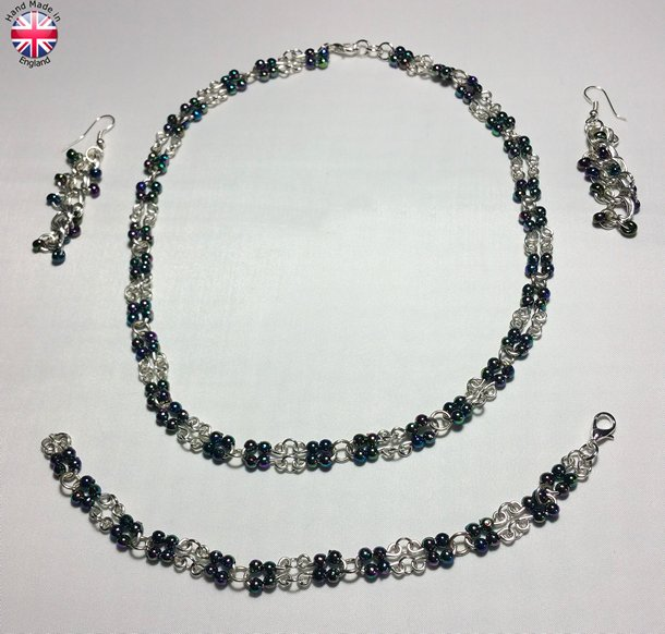 Necklace Earings and Bracelet set of Hand made silver plate bead carriers and links with irridescent black acrylic beads