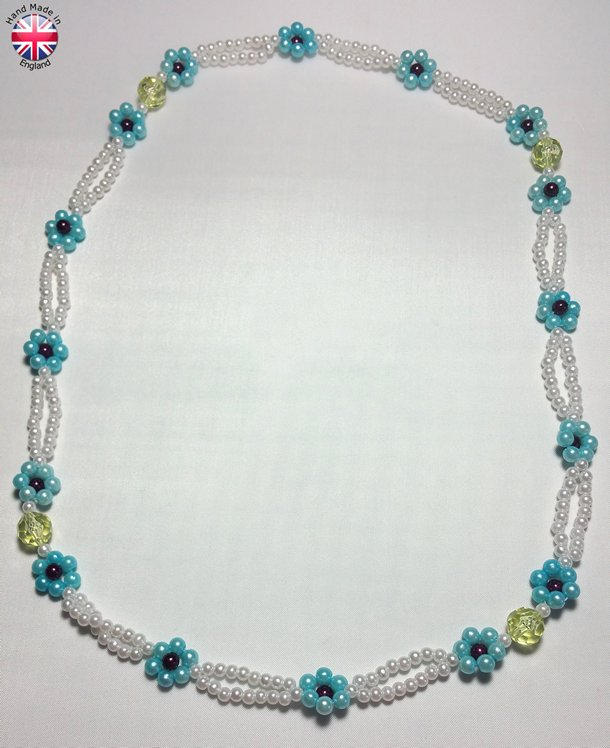 Twin laced Necklace in acrylic white pearl beads intrespaced by clear lemon beads and strung flower motifs.