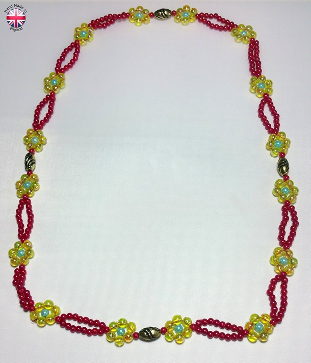 Twin laced Necklace acrylic lemon yellow bicon beads intrespaced by Black and gold striped design beads and strung flower motifs.